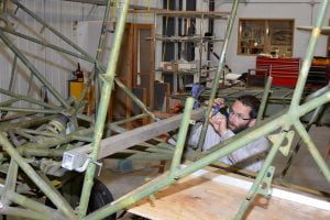 Stripped fuselage receiving detailed inspection and modifications.